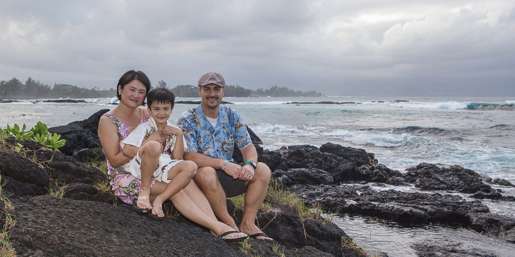 hawaii family photographer richardson ocean park family photo rocks beside ocean