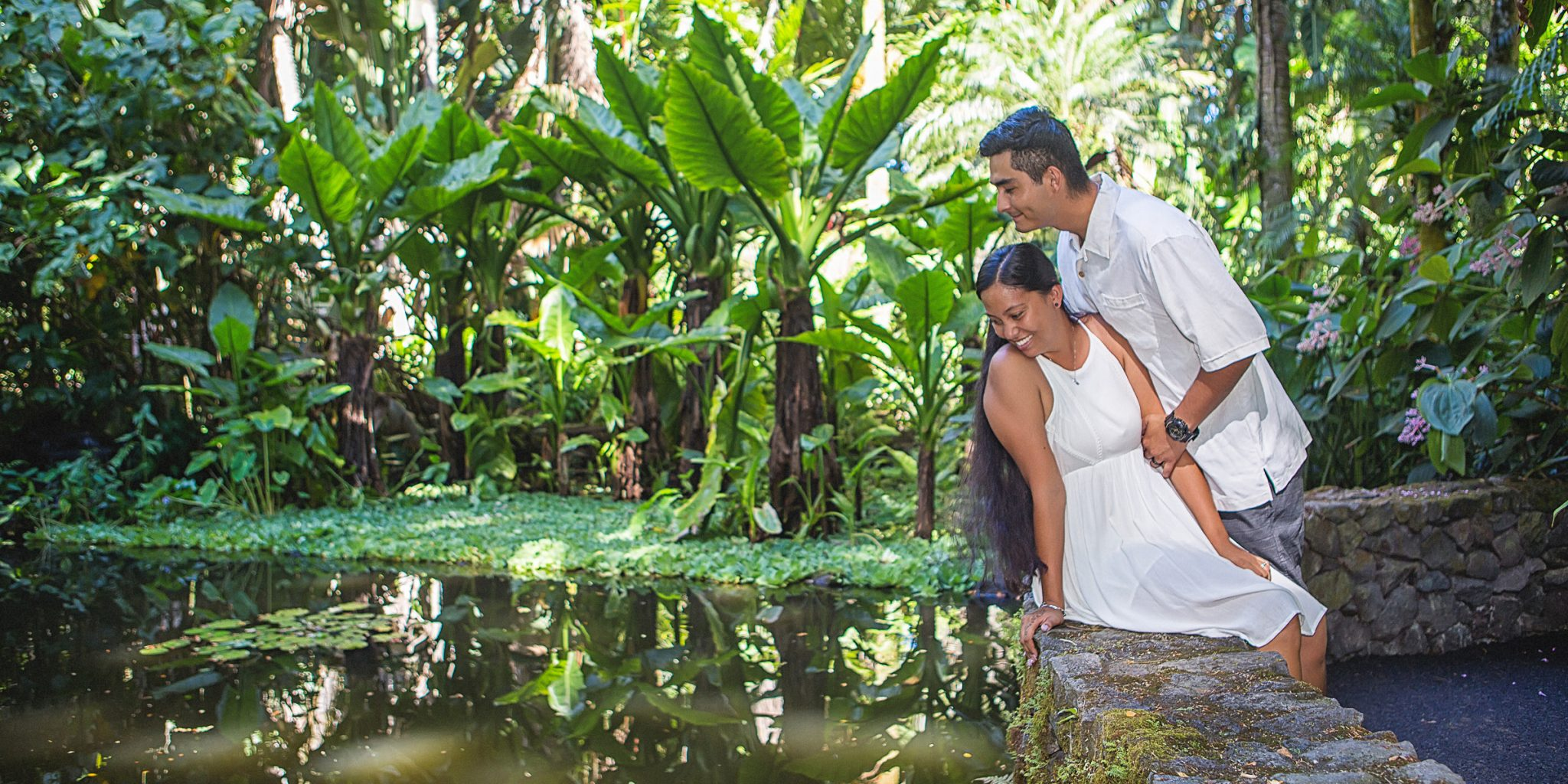 big island engagement photographer hawaii tropical botanical garden engagement session pond