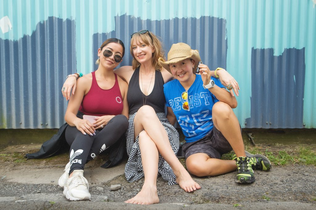three women sitting by blue metal wall Clean Food Dirty girl professional branding portrait photography hilo big island hawaii