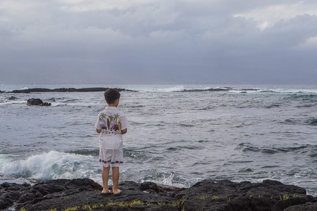 Young boy looking at waves Portrait Photography Richardson ocean park hilo big island hawaii