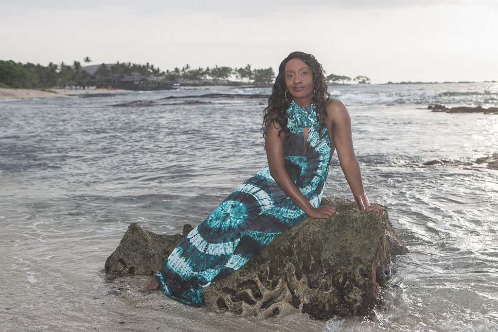 Woman sitting on beach rock Kukio Beach Portrait Photography Kailua-kona big island hawaii