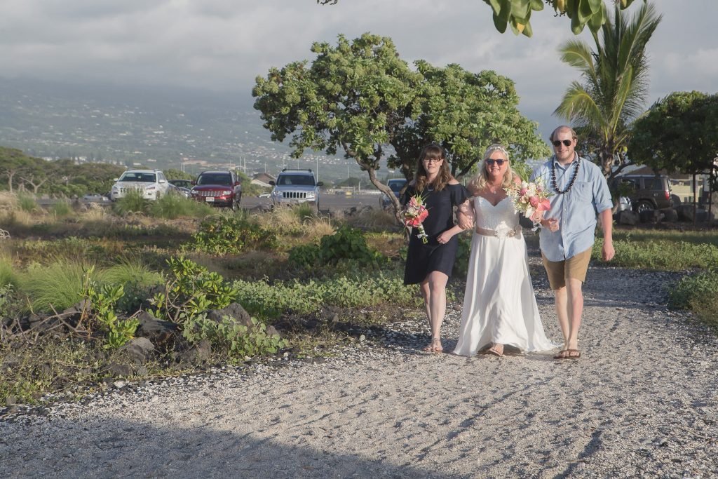 bride walking with children to ceremony with sunglasses Intimate wedding Photography old airport park Kailua-kona big island Hawaii