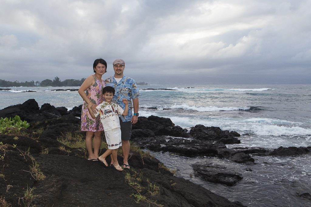 Family standing near ocean on rocks Portrait Photography Richardson ocean park hilo big island hawaii