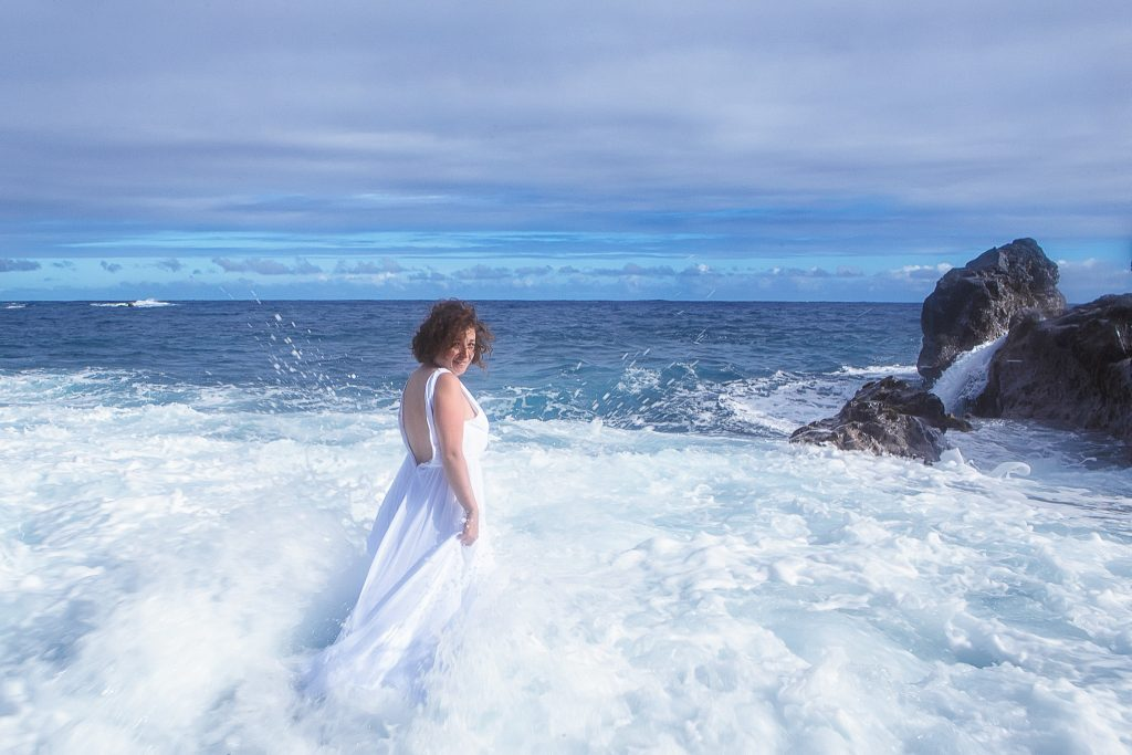 Woman standing in waves Adventure Session Portrait Photography big island hawaii