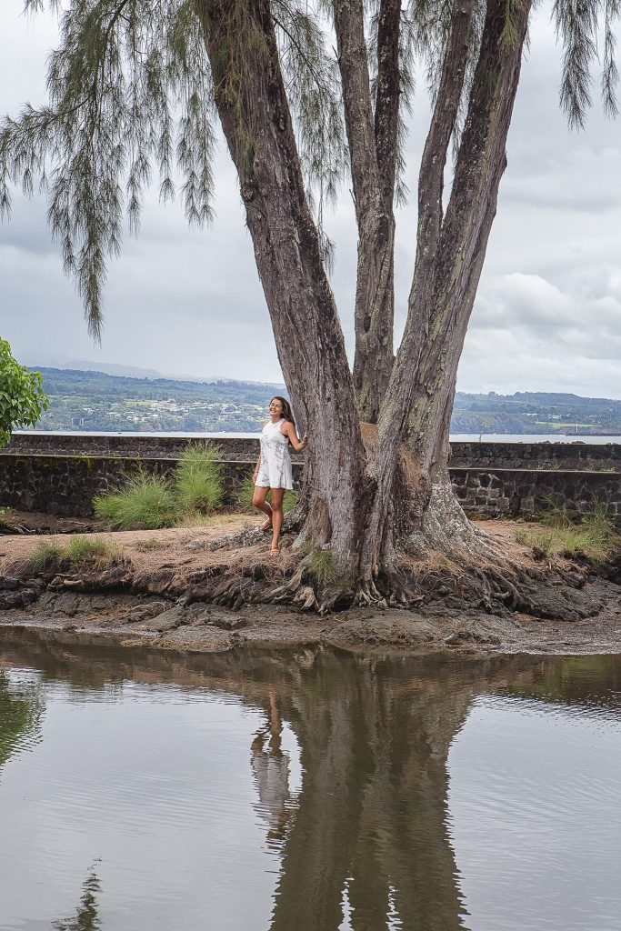 girl by tree with reflection Model Portfolio Photography Liliuokalani gardens Hilo big island hawaii