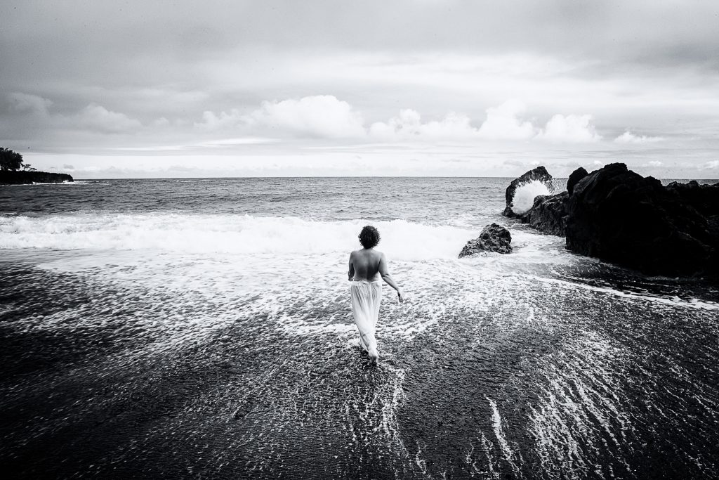 woman walking into waves black and white Adventure Session Portrait Photography big island hawaii