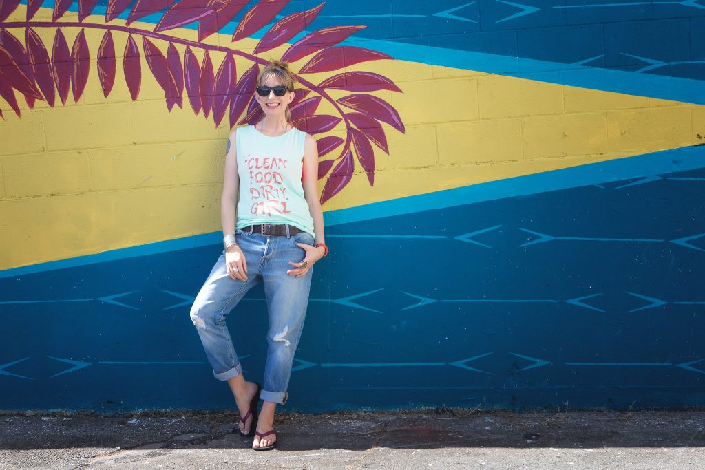 woman with sunglasses standing by graffiti wall Clean Food Dirty girl professional branding portrait photography hilo big island hawaii