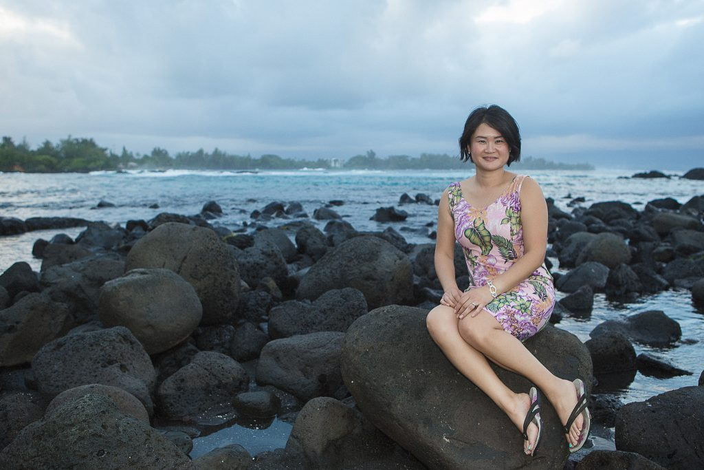 woman sitting on rock near ocean Portrait Photography Richardson ocean park hilo big island hawaii
