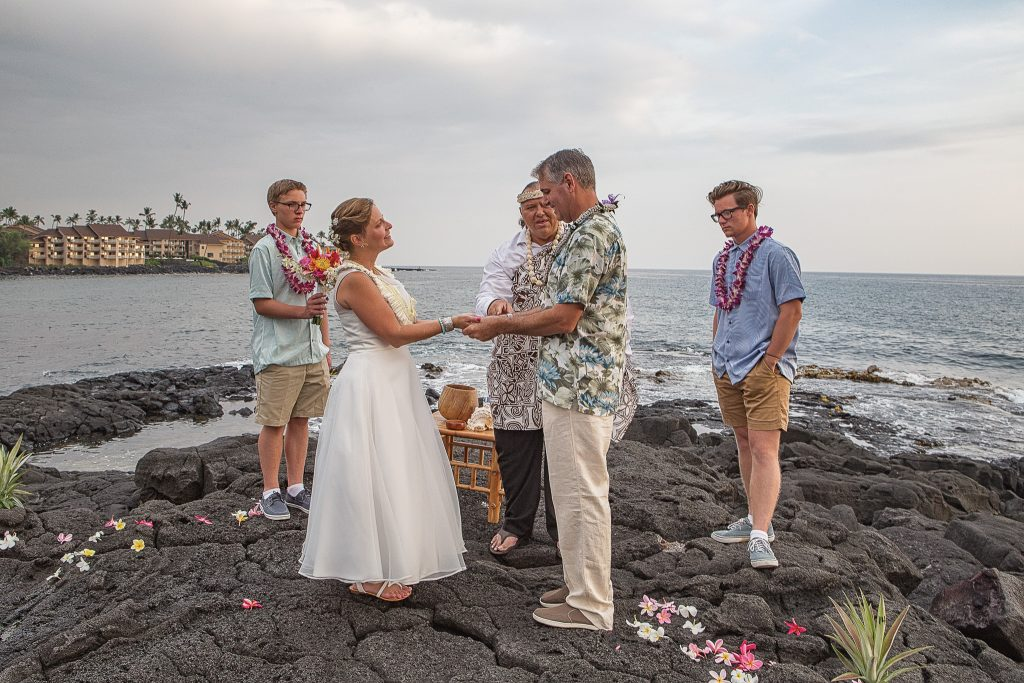 bride and groom holding hands during ceremony Wedding  photography Kailua-kona big island hawaii