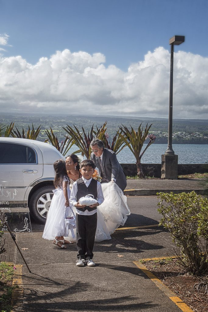 Bride getting out of limo with flower girl ring bearer and father of the bride hawaii wedding Photography hilo big island Hawaii Liliuokalani Gardens