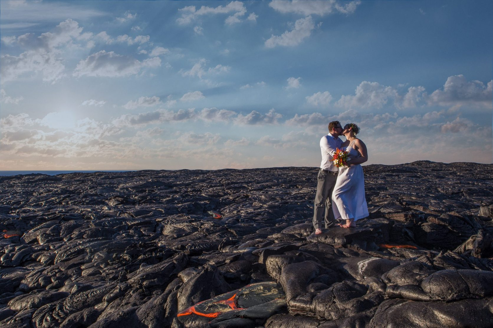 wedding couple on lava field adventure elopement big island wedding photographer