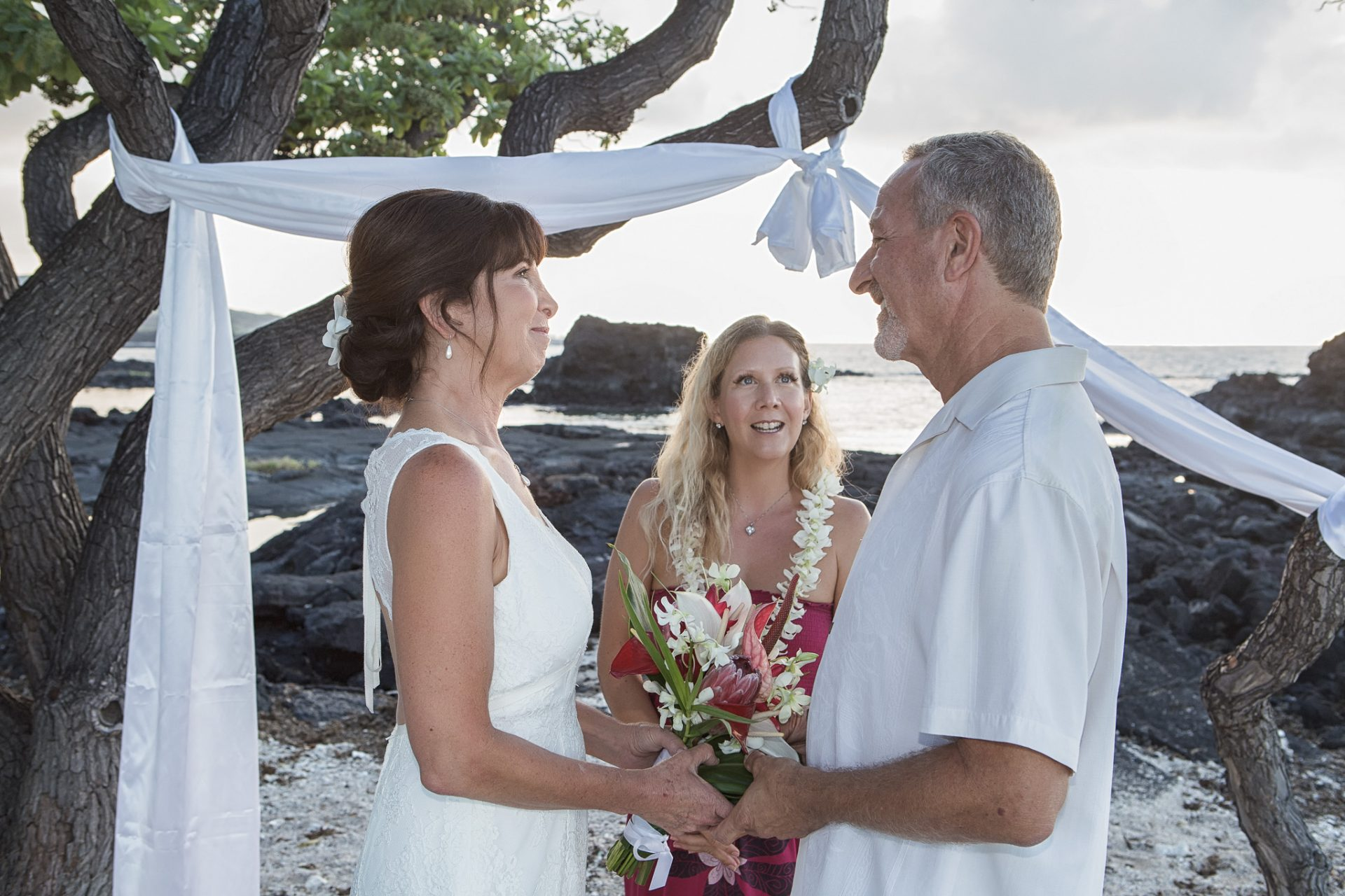 beach side wedding ceremony sunset