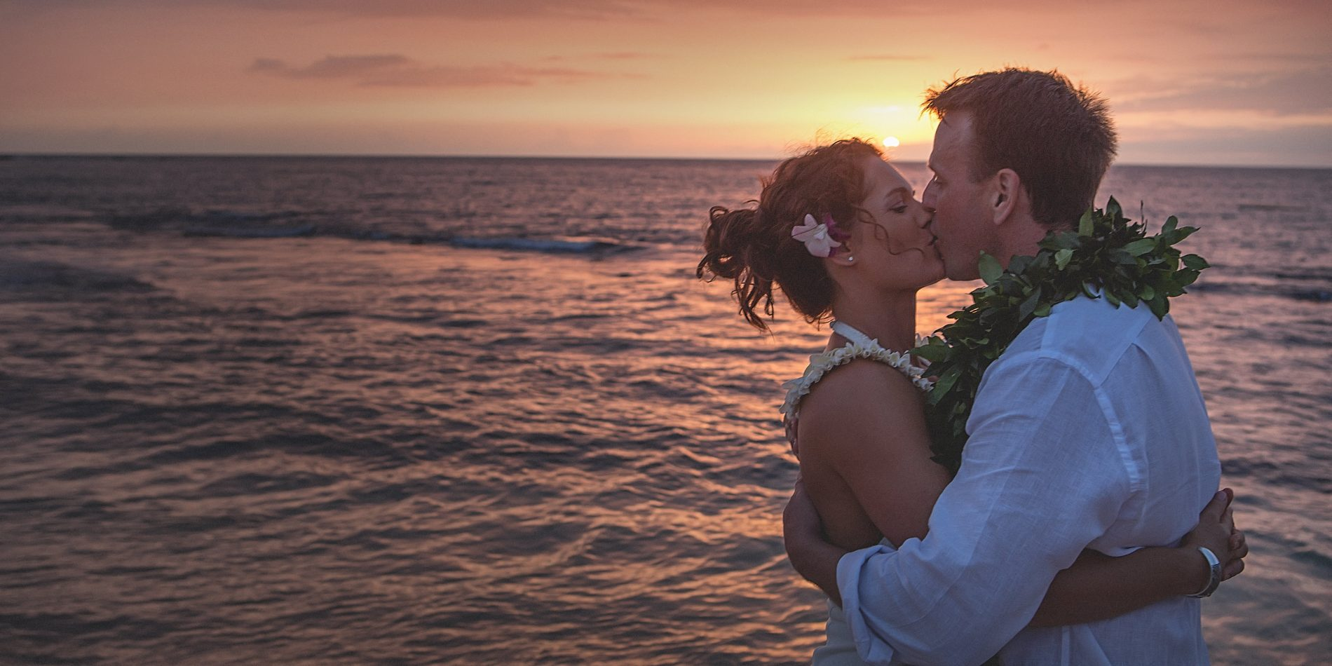 Sunset bride and groom kiss Kukio Beach Big Island Hawaii