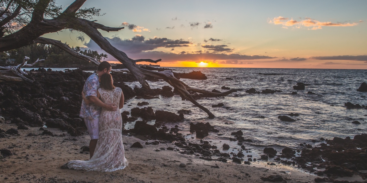 Couple dancing on beach 69 at sunset Big Island Hawaii